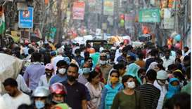 People are seen at a market amidst the spread of the coronavirus disease, in the old quarters of Del