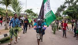 Protesters march at Alausa, the Lagos State Secretariat, in Lagos on October 20, 2020, after the Gov