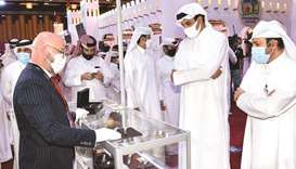The Amir viewed the exhibits including falcons, hunting and sniping supplies and the various types o