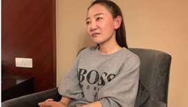 Yuan Xiaoliang, wife of Australian writer Yang Hengjun, talks to Reuters in Shanghai, China