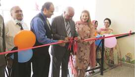 M A Shahid cutting the ribbon to inaugurate the new KG branch.