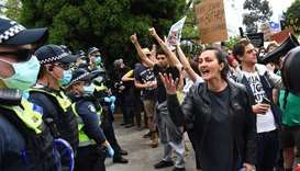 Protesters confront police during an anti-lockdown rally in Melbourne