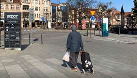 A man returns home after shopping during the outbreak of coronavirus disease (Covid-19) in Sopot, Po