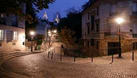 Empty streets are seen in Montmartre few minutes before the late-night curfew due to restrictions ag