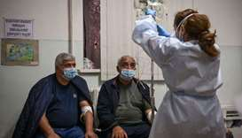 A medical staff gives treatment to patients that are suspected cases of the novel coronavirus Covid-
