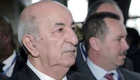 Algerian President Abdelmadjid Tebboune arrives for the opening of the 33rd Ordinary Session of the