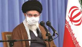 Iran's Supreme Leader Ayatollah Ali Khamenei wears a protective face mask as he gives a speech in th