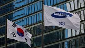 A flag bearing the logo of Samsung flutters in front of its office building in Seoul, South Korea