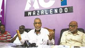 Seif Sharif Hamad (second right), the leader of the opposition, gives a press conference at The Alli