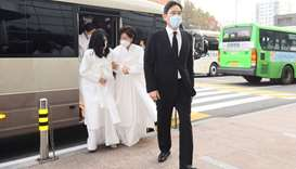 Samsung Group heir Jay Y. Lee (R) arrives for the funeral send-off held for late Samsung chairman Le