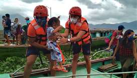 Personnel from the coast guard evacuating residents from the coastal villages of Buhi town, Camarine