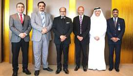 "Doha Bank Group CEO Dr. R. Seetharaman with other officials. Doha Bank has been ""recommended to cont"