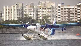 A seaplane, operated by SpiceJet's Spice Shuttle, lands in the waters of Sabarmati river after it wa