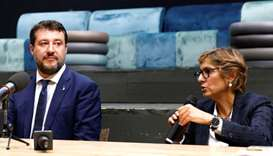 Far-right leader Matteo Salvini and his lawyer, Giulia Bongiorno attend a news conference, in Catani
