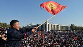 People protest against the results of a parliamentary vote in Bishkek.