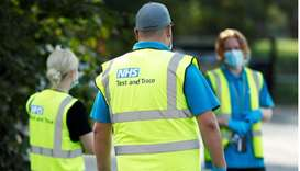 NHS Test and Trace workers are seen at a test station in Richmond-Upon-Thames, Britain, September 15