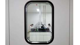 Women work in a laboratory of Chinese vaccine maker Sinovac Biotech, developing an experimental coro