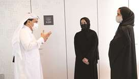 HE Sheikha Hind bint Hamad al-Thani, HE Dr Ali al-Marri and Buthaina Ali al-Nuaimi interact at the s