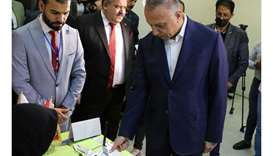 Iraqi Prime Minister Mustafa Al-Kadhimi casts his vote at the polling station at the Green Zone in B
