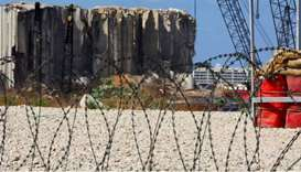Razor wire is pictured in front of the site of the 2020 Beirut port explosion, Lebanon September 29,