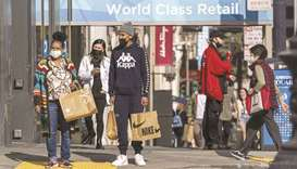 Pedestrians carry shopping bags in San Francisco. US retail sales unexpectedly rose in September, bo
