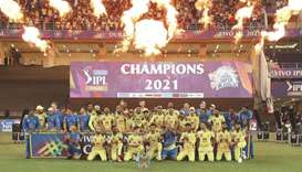 CSK players and officials celebrate with the IPL trophy after beating KKR in the final in Dubai yest