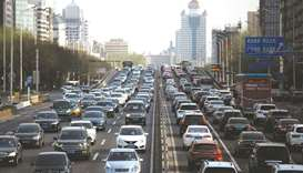 Cars are seen in a traffic jam during evening rush hour in Beijing. Most buyers are seeking US grade