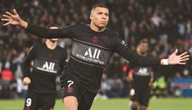 Paris Saint-Germain's French forward Kylian Mbappe celebrates after scoring a penalty during the F