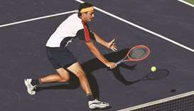 Taylor Fritz of the United States plays a backhand against Alexander Zverev of Germany during their