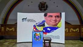 Colombian businessman Alexander Saab is projected on a screen at the National Assembly, in Caracas y