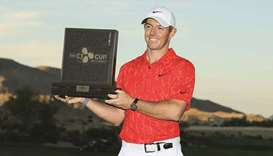 Rory McIlroy of Northern Ireland celebrates with the trophy after winning the CJ CUP in Las Vegas. (