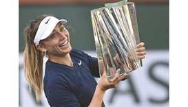 Paula Badosa of Spain holds the trophy after defeating Victoria Azarenka of Belarus in three sets in