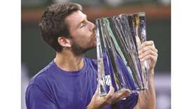 Cameron Norrie celebrates with the trophy after defeating Nikoloz Basilashvili in the final in of th