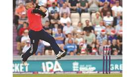 In this file photo taken on July 5, 2016, England's Tymal Mills bowls during the T20 international