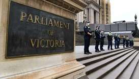 Police stand guard on the steps of Victoria's state parliament in Melbourne on September 30, 2021 as