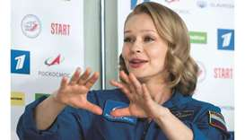 Actress Yulia Peresild gestures during an online news conference following the return from the Inter