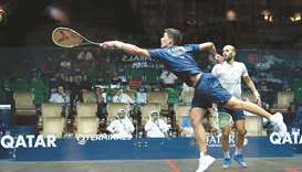 Germany's Raphael Kandra (left) stretches for the ball during his third round match against Egypt's