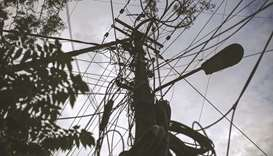 Power lines hang from a utility pole in Bengaluru, India. India is facing its worst power crisis in