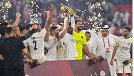 Al Sadd's players celebrate with the trophy after winning the Amir Cup final football match between