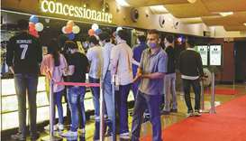 Cinema-goers queue up to buy snacks during intermission time at a cinema theatre in Mumbai yesterday