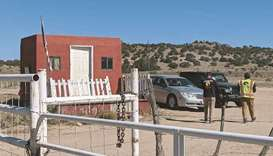 Security guards stand at the entrance of Bonanza Creek Ranch in Santa Fe, New Mexico. (AFP)