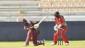 Qatar's Mohamed Rizlan plays a shot during the match against Maldives in the Asia Qualifier Group A