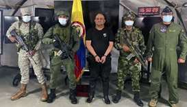 Members of the Colombian Army escorting Colombia's most-wanted drug lord and head of the Gulf Clan,
