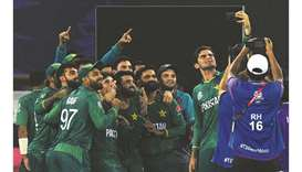 Pakistan's Shaheen Shah Afridi takes a selfie along with his teammates after winning the ICC men's T