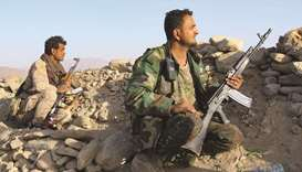 Fighters loyal to Yemen's government man a position at the frontline facing Houthi rebels in the cou