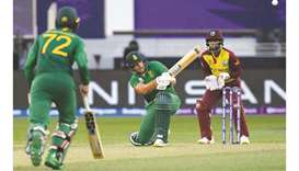 South Africa's Aiden Markram (centre) plays a shot during the ICC men's Twenty20 World Cup match aga