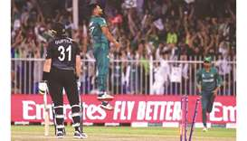 New Zealand's Martin Guptill (left) reacts after being bowled out by Pakistan's Haris Rauf (centre)