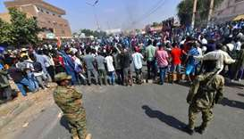 Sudanese security forces keep watch during protests against a military coup that overthrew the trans
