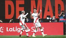 Rayo Vallecano's Radamel Falcao (right) celebrates with teammate Isi Palazon after scoring their fir