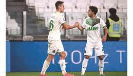 Sassuolo's Davide Frattesi (left) celebrates with Sassuolo's French Maxime Lopez after opening the s
